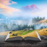 Carpathian misty mountains on the pages of book