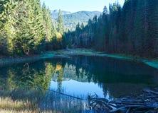 Carpathian mountain autumn landscape with lake. Stock Photos