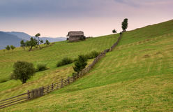 Carpathian mountain landscape with lonely wooden house Stock Photo