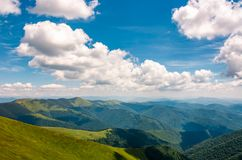 Carpathian mountain ridge under sky with clouds. Carpathian mountain ridge with its spurs under sky with clouds. beautiful summer nature scenery Stock Photos