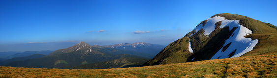 Carpathian Mountains. Panoramic photo slightly snowcapped ridge of Carpathian Mountains Stock Photo