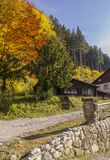 Carpathian mountains in the autumn with a wooden house. Colorful. Autumn landscape scene Royalty Free Stock Photos