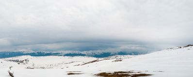 Carpathian mountains covered in snow and heavy clouds panoramic. View in winter royalty free stock images