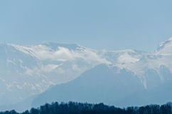Carpathian mountains in the fog, snow and ice, Europe, Romania. Royalty Free Stock Images