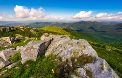 Carpathian mountains with grassy slopes and rocks. Beautiful mountainous landscape in summer Royalty Free Stock Image