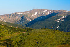 Carpathian Mountains in June. In some places the snow is not melted Royalty Free Stock Photo