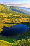 Carpathian mountains landscape in morning, panorama view from the height, Nesamovyte lake under hill. Stock Photography