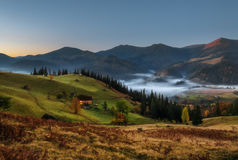 Carpathian Mountains. Moonlit Night in the mountains, the village on the hill in the fog. Stock Images