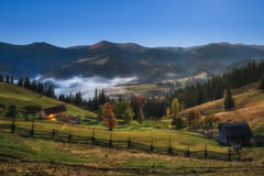 Carpathian Mountains. Moonlit Night in the mountains, the village on the hill in the fog. Royalty Free Stock Photography