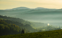 The Carpathian Mountains in the morning through the fog Royalty Free Stock Photography