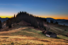 Carpathian Mountains. Morning in the mountains, the house on the hillside. Stock Photo