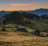 Carpathian Mountains. Morning in the mountains, the house on the hillside. Stock Image