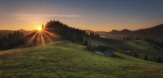 Carpathian Mountains. Morning in the mountains, the house on the hillside. Royalty Free Stock Photos