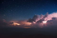 Carpathian Mountains. Mount Pop Ivan. Thunderhead and the starry sky above the ridge Montenegrin Royalty Free Stock Photo