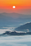 Carpathian Mountains. Mountains covered in mist at sunrise. Stock Photos