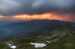 Carpathian Mountains. Ominous sky and sunset. Ukraine. Mountain scenery of the Carpathians stock photos