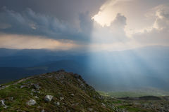 Carpathian Mountains. The rays breaking through the clouds illuminating the ground Royalty Free Stock Photo