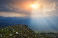 Carpathian Mountains. The rays breaking through the clouds illuminating the ground Royalty Free Stock Photography