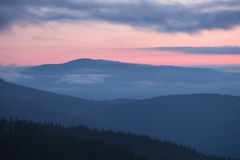 Carpathian mountains silhoutte at sunrise Stock Photos