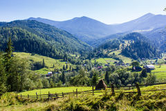 Carpathian mountains. Small village between blue Carpathian mountains Royalty Free Stock Images