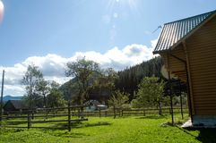 Carpathian mountains summer landscape with green hills and wooden fence, Royalty Free Stock Photo
