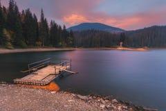 Carpathian Mountains. Synevir lake morning raft Royalty Free Stock Photo