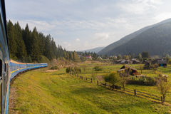 Carpathian mountains, the village and train Royalty Free Stock Photo