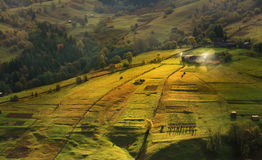 Carpathian september. Early summer morning in a small Carpathian village. The first rays of the sun lit slopes Carpathian rolling landscape on sunset in summer Stock Image