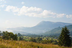 Carpathian village at the foot of Goverla mountain. July warm afternoon in the highlands of Ukrainian mountains. Goverla mountain Stock Image