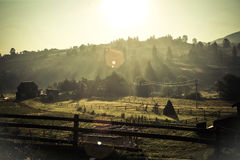 Carpathian village. The sunny morning. Far away village in Carpathian mountains at the foot of Goverla mountain Royalty Free Stock Image