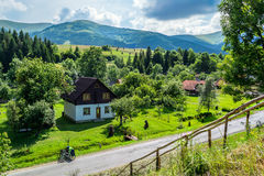 Carpathian village. Ukrainian mountain Carpathian village Pylypets' near waterfall Shipit. Summer Royalty Free Stock Photos