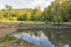 Carpathians landscape with small lake. In autumn. Ukrainian Transcarpathian region, Mukachevo district Stock Photo