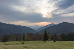 Carpathians, mountains the dawn sun. Dawn in the mountains above Lake Synevyr Spring 2014 Royalty Free Stock Images