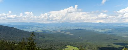 Carpathians mountains at summer, west Ukraine. Nature panoramic landscape. Mountain range covered with green dense. Forest of pines and firs. Blue sky with stock photography