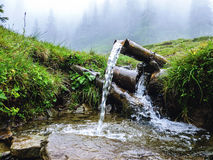 Carpathians, source of spring water, near mount Petros Royalty Free Stock Photo