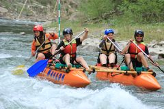Participants in the kayaking competition are eager for victory and quickly paddle. Carpathians, Ukraine - May 9, 2018: Participants in the kayaking competition royalty free stock photography