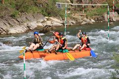 Participants in the kayaking competition are eager for victory and quickly paddle. Carpathians, Ukraine - May 9, 2018: Participants in the kayaking competition stock photography