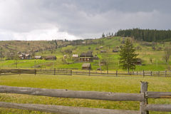 Carpathians valley. Village at spring before rain. Ukraine Stock Photos