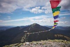 Carpathians View through prayer flags. Synyak, Chomiak Ridge, Ukraine Stock Photos