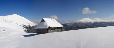 Carpathians in winter. Rescue shelter on a background of mountains  Petros and Goverla, Carpathians Stock Photography