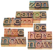 Carpe DIem and zen. Carpe Diem, live now, be here now, zen - a collage of spiritual reminders and words  in vintage wood letterpress type, stained by color inks Royalty Free Stock Photo