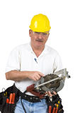 Carpenter. Checking circular saw blade for sharpness on a white background Stock Photos