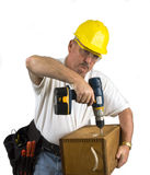 Carpenter. Using electric drill to build box Royalty Free Stock Photography