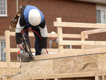 Carpenter. Framing a new home Royalty Free Stock Photography