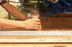 Carpenter. Is cutting wood at the workplace Stock Images