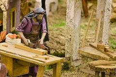 Carpenter. Figurine from a typical crib scene Stock Image