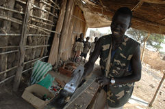 Carpenter. A Sudanese carpenter works in the shade in his village of Kuda Royalty Free Stock Images