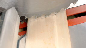 Carpenter adjusts saw blade stock footage