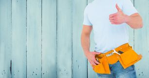 Carpenter against blue wood panel Royalty Free Stock Photography