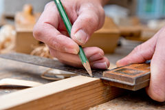 Carpenter with angle. Carpenter makes marks with angle Stock Photo